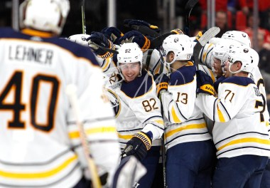Feb 22, 2018; Detroit, MI, USA; Buffalo Sabres defenseman Nathan Beaulieu (82) looks at goaltender Robin Lehner (40) while celebrating with teammates in overtime against the Detroit Red Wings at Little Caesars Arena. Mandatory Credit: Raj Mehta-USA TODAY Sports