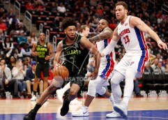 Feb 14, 2018; Detroit, MI, USA; Atlanta Hawks guard Tyler Dorsey (2) dribbles the ball against Detroit Pistons forward Blake Griffin (23) during the fourth quarter at Little Caesars Arena. Mandatory Credit: Raj Mehta-USA TODAY Sports