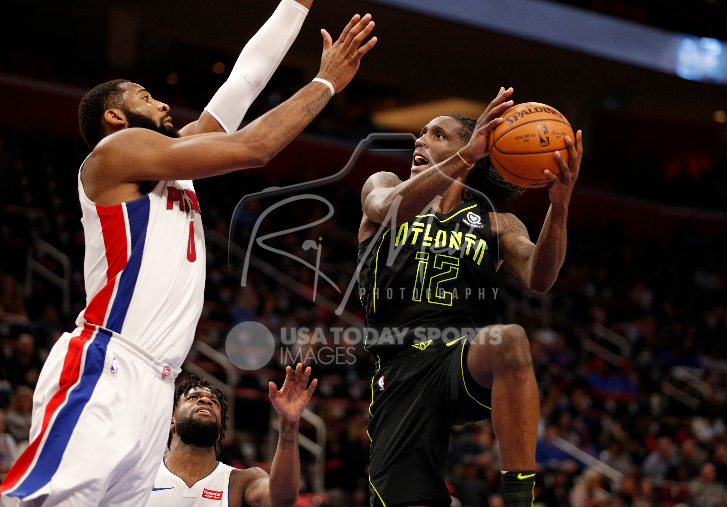 Feb 14, 2018; Detroit, MI, USA; Atlanta Hawks forward Taurean Prince (12) takes a shot against Detroit Pistons center Andre Drummond (0) during the fourth quarter at Little Caesars Arena. Mandatory Credit: Raj Mehta-USA TODAY Sports