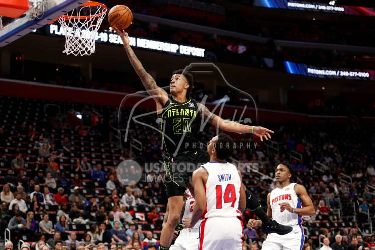 Feb 14, 2018; Detroit, MI, USA; Atlanta Hawks forward John Collins (20) takes a shot against Detroit Pistons guard Ish Smith (14) during the fourth quarter at Little Caesars Arena. Mandatory Credit: Raj Mehta-USA TODAY Sports