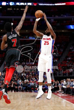 Mar 24, 2018; Detroit, MI, USA; Detroit Pistons guard Reggie Bullock (25) takes a shot against Chicago Bulls guard Justin Holiday (7) during the second quarter at Little Caesars Arena. Mandatory Credit: Raj Mehta-USA TODAY Sports