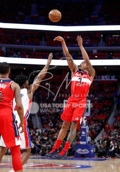 Mar 29, 2018; Detroit, MI, USA; Washington Wizards guard Bradley Beal (3) takes a shot over Detroit Pistons forward Stanley Johnson (7) during the second quarter at Little Caesars Arena. Mandatory Credit: Raj Mehta-USA TODAY Sports