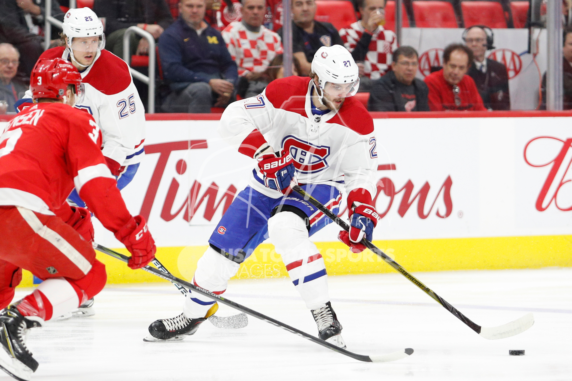 Apr 5, 2018; Detroit, MI, USA; Montreal Canadiens left wing Alex Galchenyuk (27) skates with the puck against Detroit Red Wings defenseman Nick Jensen (3) during the first period at Little Caesars Arena. Mandatory Credit: Raj Mehta-USA TODAY Sports