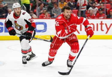 Mar 31, 2018; Detroit, MI, USA; Detroit Red Wings right wing Luke Glendening (41) chases the puck with his helmet off against Ottawa Senators defenseman Fredrik Claesson (33) during the second period at Little Caesars Arena. Mandatory Credit: Raj Mehta-USA TODAY Sports