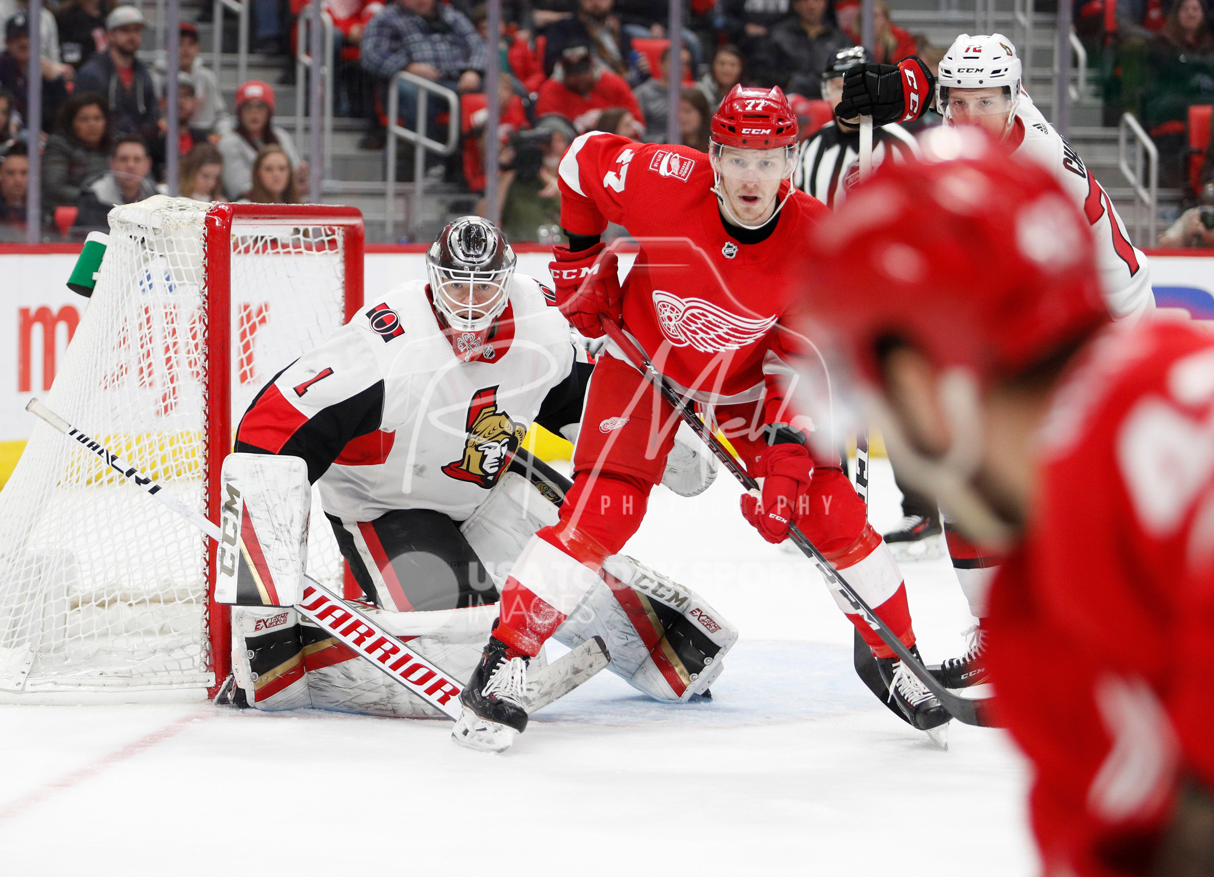 Mar 31, 2018; Detroit, MI, USA; Ottawa Senators goaltender Mike Condon (1) protects the side of the net against Detroit Red Wings right wing Evgeny Svechnikov (77) during the second period at Little Caesars Arena. Mandatory Credit: Raj Mehta-USA TODAY Sports