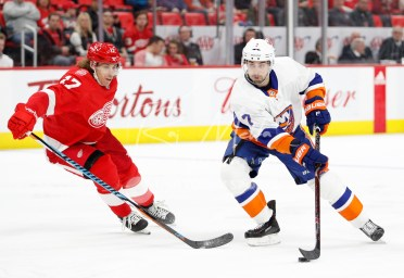 Apr 7, 2018; Detroit, MI, USA; New York Islanders center Jordan Eberle (7) gets defended by Detroit Red Wings left wing David Booth (17) during the third period at Little Caesars Arena. Mandatory Credit: Raj Mehta-USA TODAY Sports