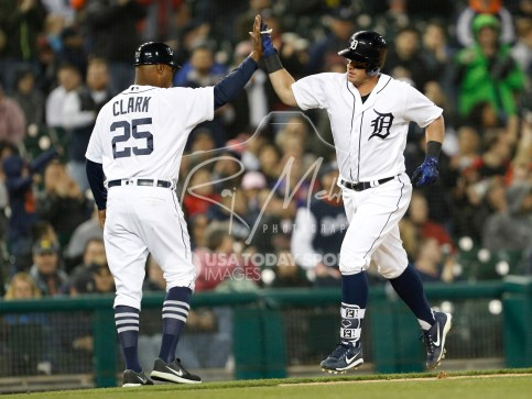 Apr 13, 2018; Detroit, MI, USA; Detroit Tigers catcher James McCann (34) gives five to third base coach Dave Clark (25) during the fifth inning after hitting a solo home run against the New York Yankees at Comerica Park. Mandatory Credit: Raj Mehta-USA TODAY Sports