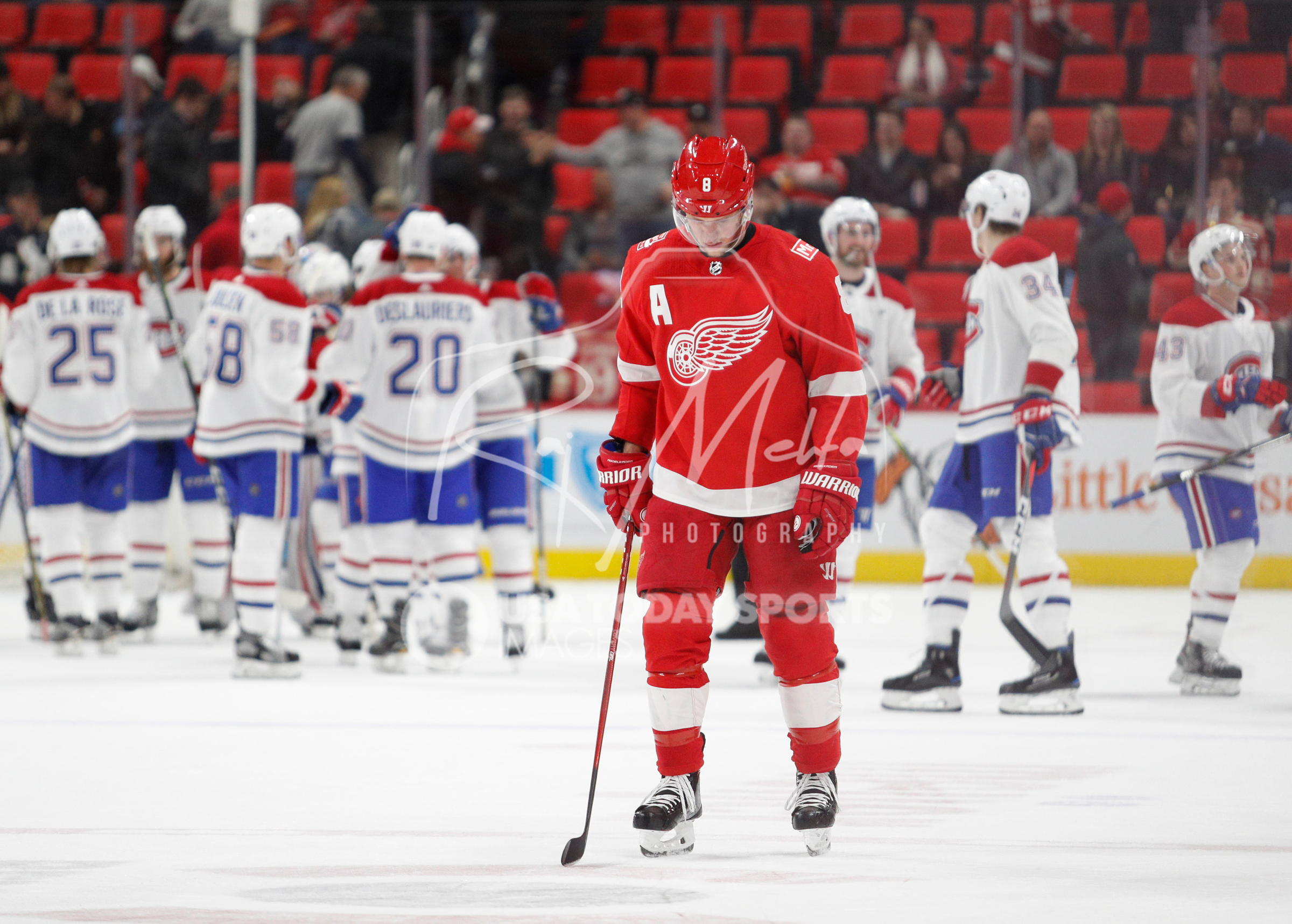 Apr 5, 2018; Detroit, MI, USA; Detroit Red Wings left wing Justin Abdelkader (8) looks down as the Montreal Canadiens celebrate behind him after the game at Little Caesars Arena. Mandatory Credit: Raj Mehta-USA TODAY Sports