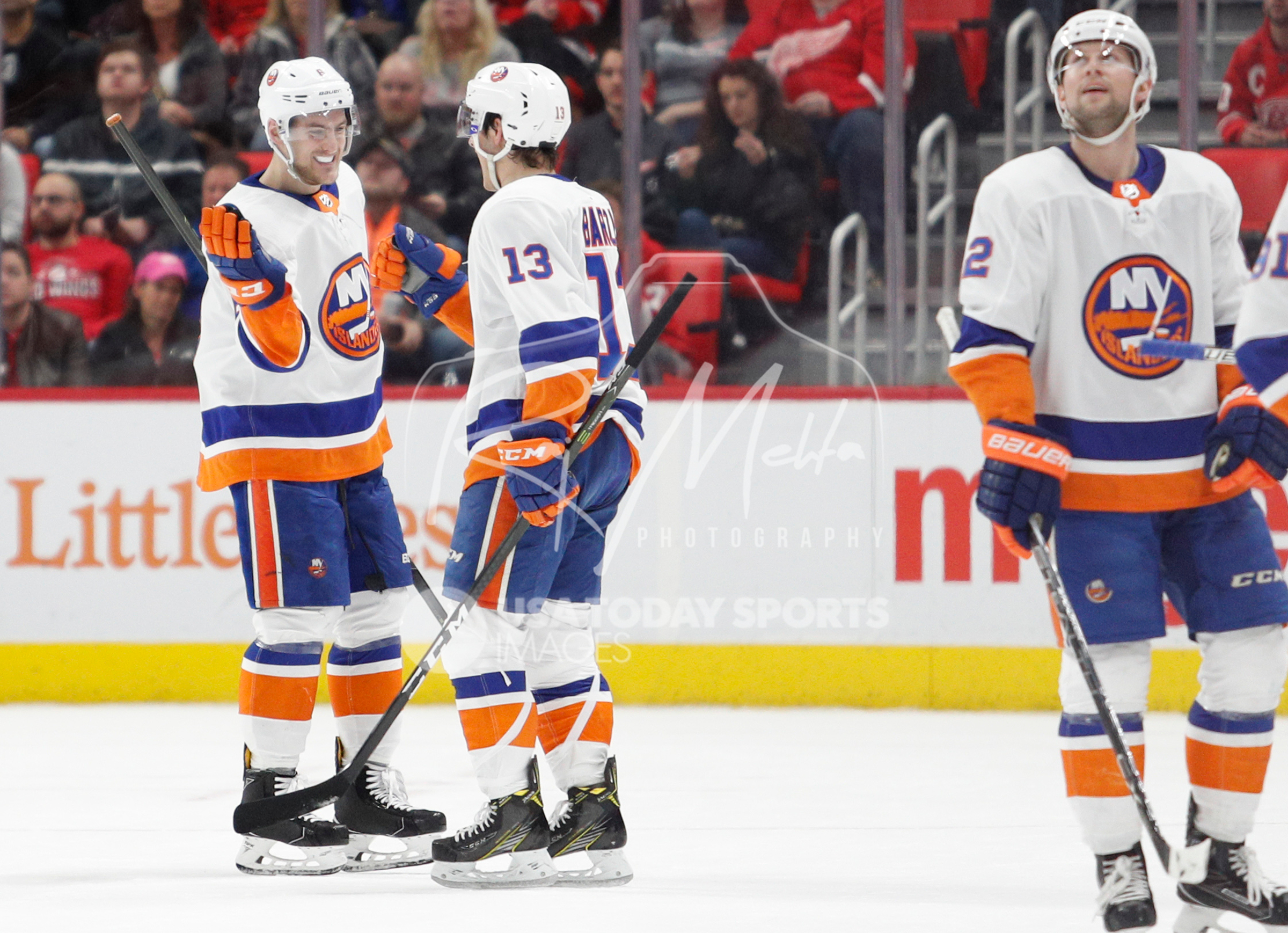 Apr 7, 2018; Detroit, MI, USA; New York Islanders defenseman Ryan Pulock (6) celebrates with center Mathew Barzal (13) after scoring a goal during the third period against the Detroit Red Wings at Little Caesars Arena. Mandatory Credit: Raj Mehta-USA TODAY Sports