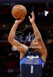 Apr 6, 2018; Detroit, MI, USA; Dallas Mavericks guard Dennis Smith Jr. (1) takes a shot during the first quarter against the Detroit Pistons at Little Caesars Arena. Mandatory Credit: Raj Mehta-USA TODAY Sports