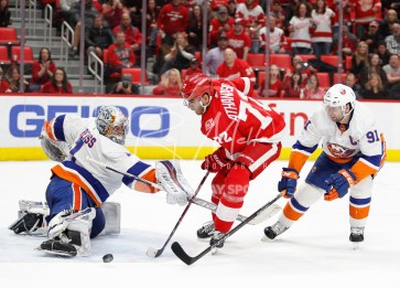 Apr 7, 2018; Detroit, MI, USA; New York Islanders goaltender Thomas Greiss (1) makes a save against Detroit Red Wings left wing Andreas Athanasiou (72) during overtime at Little Caesars Arena. Mandatory Credit: Raj Mehta-USA TODAY Sports