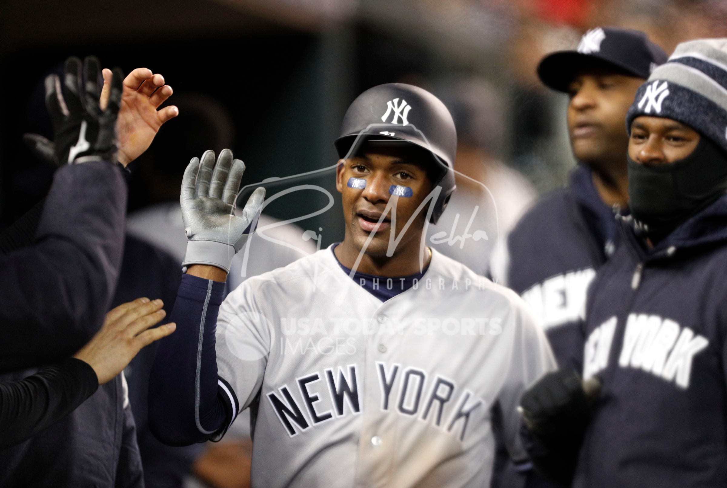 Apr 13, 2018; Detroit, MI, USA; New York Yankees third baseman Miguel Andujar (41) celebrates with teammates after scoring a run during the eighth inning against the Detroit Tigers at Comerica Park. Mandatory Credit: Raj Mehta-USA TODAY Sports