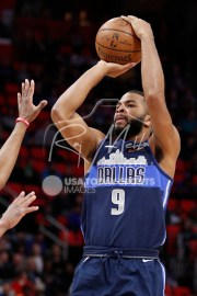 Apr 6, 2018; Detroit, MI, USA; Dallas Mavericks guard Aaron Harrison (9) takes a shot against the Detroit Pistons during the second quarter at Little Caesars Arena. Mandatory Credit: Raj Mehta-USA TODAY Sports