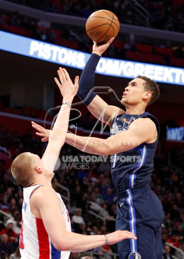 Apr 6, 2018; Detroit, MI, USA; Dallas Mavericks center Dwight Powell (7) takes a shot over Detroit Pistons forward Henry Ellenson (8) during the second quarter at Little Caesars Arena. Mandatory Credit: Raj Mehta-USA TODAY Sports