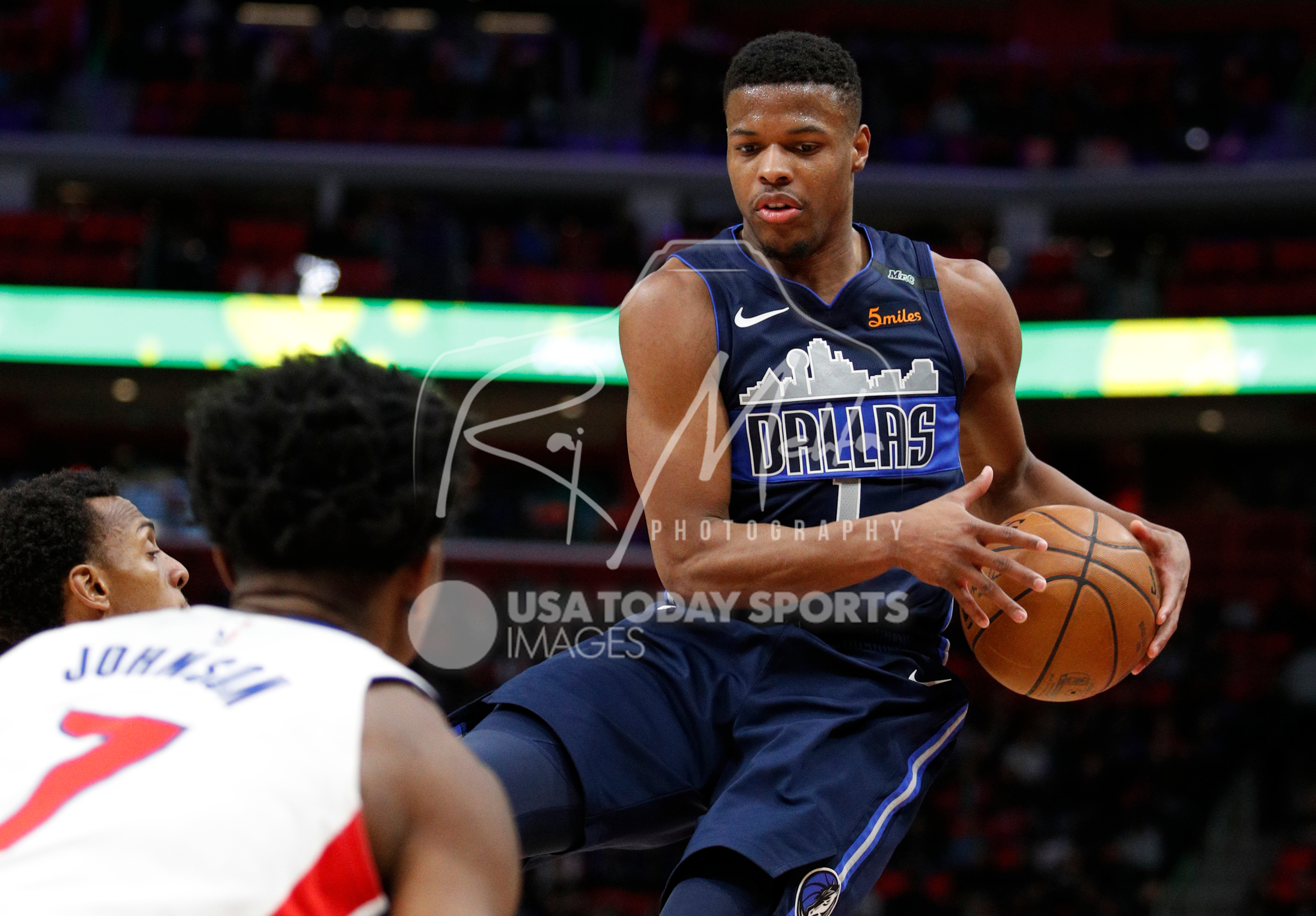 Apr 6, 2018; Detroit, MI, USA; Dallas Mavericks guard Dennis Smith Jr. (1) jumps in the air with the ball during the second quarter against the Detroit Pistons at Little Caesars Arena. Mandatory Credit: Raj Mehta-USA TODAY Sports