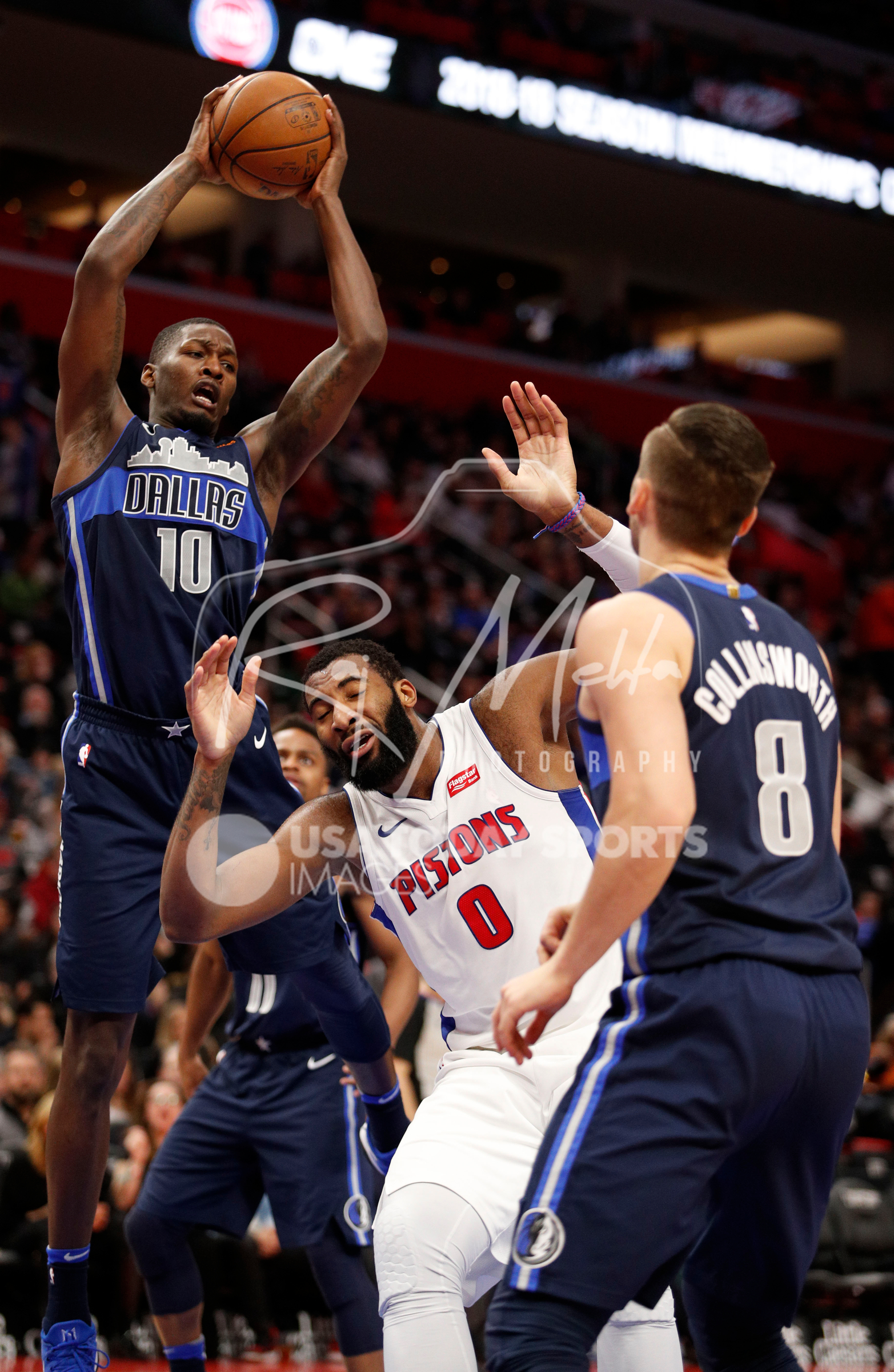 Apr 6, 2018; Detroit, MI, USA; Dallas Mavericks forward Dorian Finney-Smith (10) grabs the ball over Detroit Pistons center Andre Drummond (0) during the fourth quarter at Little Caesars Arena. Mandatory Credit: Raj Mehta-USA TODAY Sports