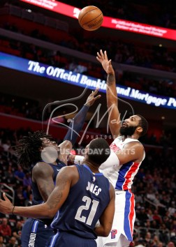 Apr 6, 2018; Detroit, MI, USA; Detroit Pistons center Andre Drummond (0) takes a shot over Dallas Mavericks forward Johnathan Motley (6) and forward Jalen Jones (21) during the fourth quarter at Little Caesars Arena. Mandatory Credit: Raj Mehta-USA TODAY Sports