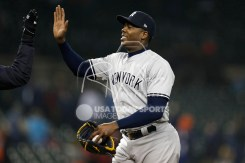 Apr 13, 2018; Detroit, MI, USA; New York Yankees relief pitcher Aroldis Chapman (54) gives a high five to manager Aaron Boone after the game against the Detroit Tigers at Comerica Park. Mandatory Credit: Raj Mehta-USA TODAY Sports