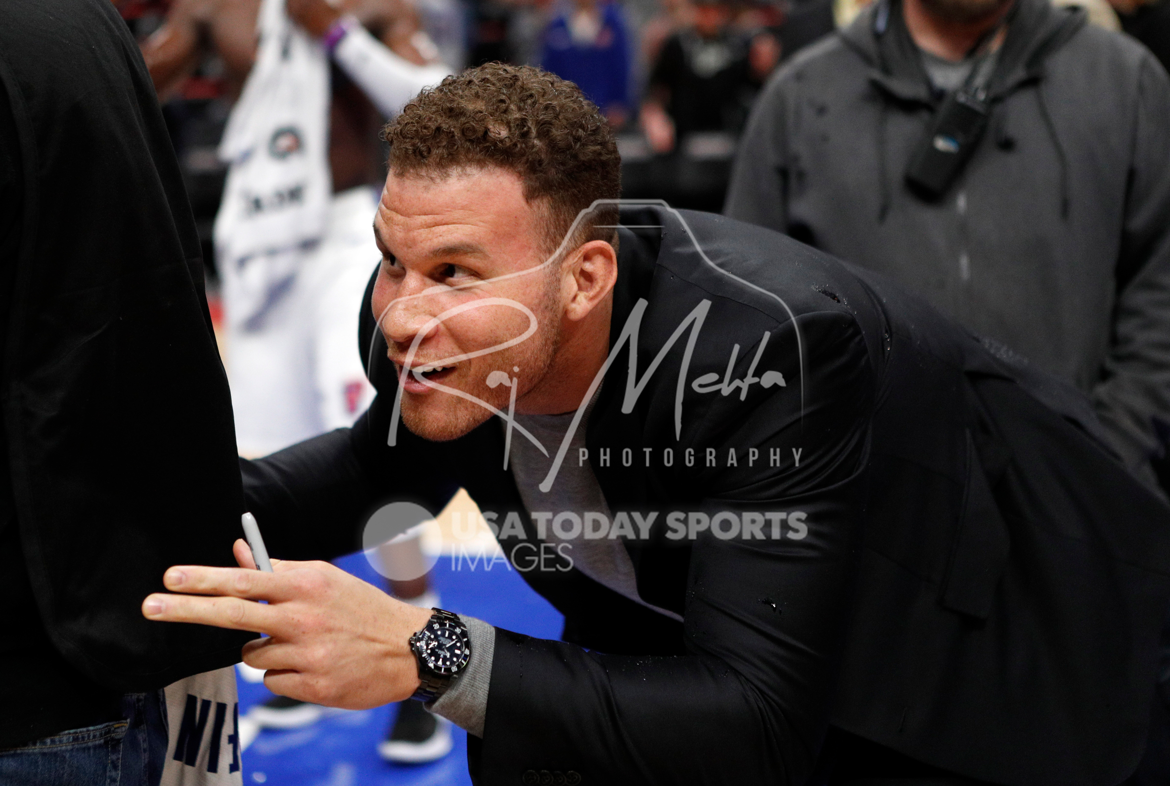 Apr 6, 2018; Detroit, MI, USA; Detroit Pistons forward Blake Griffin (23) hids behind a photographer to stay dry after the game against the Dallas Mavericks at Little Caesars Arena. Mandatory Credit: Raj Mehta-USA TODAY Sports