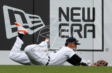 Jul 22, 2018; Detroit, MI, USA; Detroit Tigers right fielder Victor Reyes (22) cant make the catch on a ball hit by Boston Red Sox left fielder Andrew Benintendi (not pictured) during the seventh inning at Comerica Park. Mandatory Credit: Raj Mehta-USA TODAY Sports