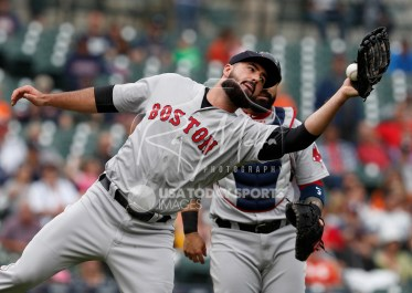 Jul 22, 2018; Detroit, MI, USA; Boston Red Sox relief pitcher Brandon Workman (44) makes a catch for an out during the seventh inning against the Detroit Tigers at Comerica Park. Mandatory Credit: Raj Mehta-USA TODAY Sports