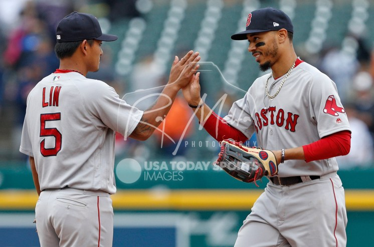 Jul 22, 2018; Detroit, MI, USA; Boston Red Sox right fielder Mookie Betts (right) celebrates with shortstop Tzu-Wei Lin (5) after the game against the Detroit Tigers at Comerica Park. Mandatory Credit: Raj Mehta-USA TODAY Sports