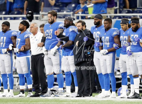 Aug 17, 2018; Detroit, MI, USA; Detroit Lions head coach Matt Patricia (black attire) locks arms with his team during the national anthem before the game against the New York Giants at Ford Field. Mandatory Credit: Raj Mehta-USA TODAY Sports