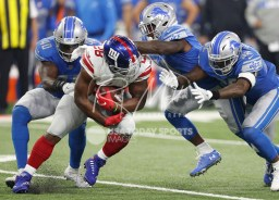 Aug 17, 2018; Detroit, MI, USA; New York Giants running back Jonathan Stewart (28) gets surrounded by Detroit Lions linebacker Jarrad Davis (40) defensive back Nevin Lawson (24) and defensive back Tavon Wilson (32) during the first quarter at Ford Field. Mandatory Credit: Raj Mehta-USA TODAY Sports