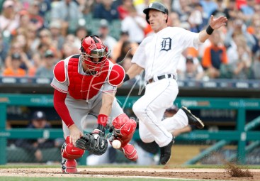 Aug 1, 2018; Detroit, MI, USA; Cincinnati Reds catcher Curt Casali (38) gathers the ball as Detroit Tigers right fielder Jim Adduci (37) slides safe into home plate during the second inning at Comerica Park. Mandatory Credit: Raj Mehta-USA TODAY Sports