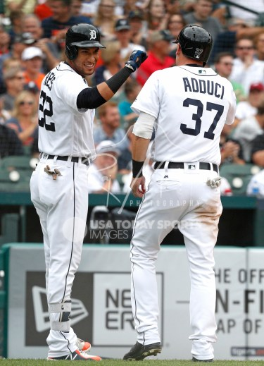 Aug 1, 2018; Detroit, MI, USA; Detroit Tigers right fielder Victor Reyes (22) celebrates with right fielder Jim Adduci (37) after scoring a run during the second inning against the Cincinnati Reds at Comerica Park. Mandatory Credit: Raj Mehta-USA TODAY Sports