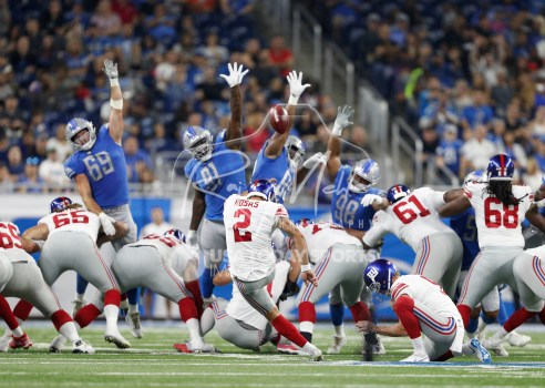 Aug 17, 2018; Detroit, MI, USA; New York Giants kicker Aldrick Rosas (2) kicks a field goal over Detroit Lions defensive end Anthony Zettel (69) defensive tackle A'Shawn Robinson (91) defensive end Cornelius Washington (90) and defensive tackle Jeremiah Ledbetter (98) at Ford Field. Mandatory Credit: Raj Mehta-USA TODAY Sports