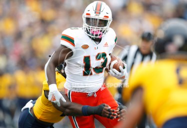 Sep 15, 2018; Toledo, OH, USA; Miami Hurricanes running back DeeJay Dallas (13) runs the ball during the first quarter against the Toledo Rockets at Glass Bowl. Mandatory Credit: Raj Mehta-USA TODAY Sports