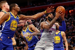 Dec 1, 2018; Detroit, MI, USA; Detroit Pistons center Andre Drummond (0) gets a rebound against Golden State Warriors forward Kevin Durant (35) and center Damian Jones (15) during the first quarter at Little Caesars Arena. Mandatory Credit: Raj Mehta-USA TODAY Sports