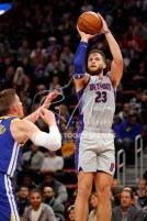 Dec 1, 2018; Detroit, MI, USA; Detroit Pistons forward Blake Griffin (23) takes a shot over Golden State Warriors forward Jonas Jerebko (21) during the first quarter at Little Caesars Arena. Mandatory Credit: Raj Mehta-USA TODAY Sports