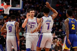 Dec 1, 2018; Detroit, MI, USA; Detroit Pistons center Zaza Pachulia (27) celebrates with forward Stanley Johnson (7) during the second quarter against the Golden State Warriors at Little Caesars Arena. Mandatory Credit: Raj Mehta-USA TODAY Sports