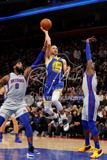 Dec 1, 2018; Detroit, MI, USA; Golden State Warriors guard Stephen Curry (30) goes up for a shot against Detroit Pistons guard Reggie Jackson (1) and center Andre Drummond (0) during the fourth quarter at Little Caesars Arena. Mandatory Credit: Raj Mehta-USA TODAY Sports