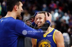 Dec 1, 2018; Detroit, MI, USA; Detroit Pistons center Zaza Pachulia (27) hugs Golden State Warriors guard Stephen Curry (30) after the game at Little Caesars Arena. Mandatory Credit: Raj Mehta-USA TODAY Sports
