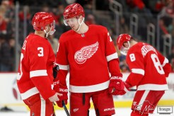 Feb 27, 2020; Detroit, Michigan, USA; Detroit Red Wings center Christoffer Ehn (70) talks with defenseman Alex Biega (3) during the first period against the Minnesota Wild at Little Caesars Arena. Mandatory Credit: Raj Mehta-USA TODAY Sports