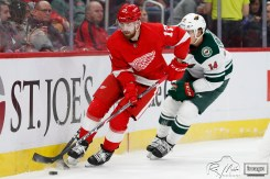 Feb 27, 2020; Detroit, Michigan, USA; Detroit Red Wings defenseman Filip Hronek (17) skates with the puck against Minnesota Wild center Joel Eriksson Ek (14) during the first period at Little Caesars Arena. Mandatory Credit: Raj Mehta-USA TODAY Sports