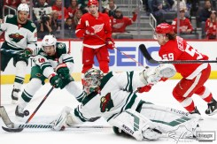 Feb 27, 2020; Detroit, Michigan, USA; Minnesota Wild defenseman Jared Spurgeon (46) and goaltender Alex Stalock (32) keep the puck out of the net against Detroit Red Wings left wing Tyler Bertuzzi (59) during the second period at Little Caesars Arena. Mandatory Credit: Raj Mehta-USA TODAY Sports