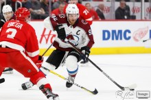 Mar 2, 2020; Detroit, Michigan, USA; Colorado Avalanche left wing Gabriel Landeskog (92) gets defended by Detroit Red Wings defenseman Alex Biega (3) during the first period at Little Caesars Arena. Mandatory Credit: Raj Mehta-USA TODAY Sports