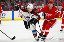 Mar 2, 2020; Detroit, Michigan, USA; Colorado Avalanche left wing Gabriel Landeskog (92) skates to the puck against Detroit Red Wings left wing Tyler Bertuzzi (59) during the first period at Little Caesars Arena. Mandatory Credit: Raj Mehta-USA TODAY Sports