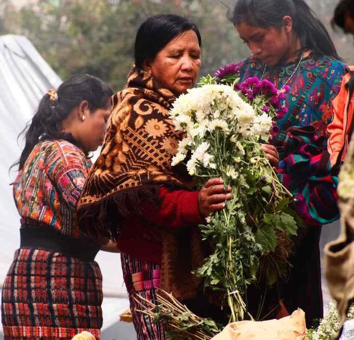 Buying flowers at Chichicastenango