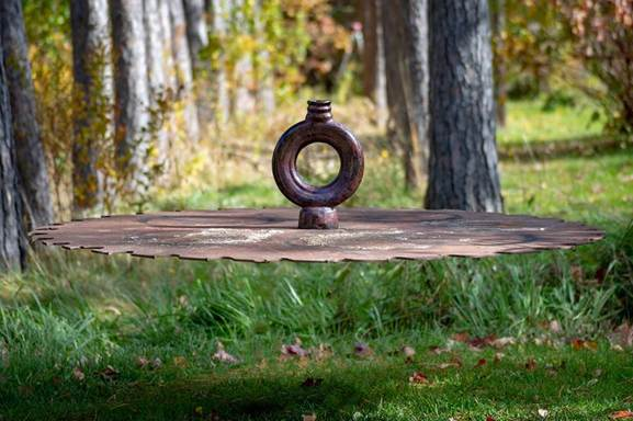 Raku pottery vase levitating in the air