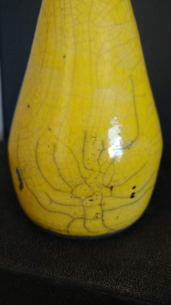 "yellow raku pottery vase called ""Haring's Dance"""