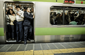 Passengers inside an overcrowded Yamanote Line train at rush hour in Tokyo Japan. Accounting the subway lines and all the other railways that operate in Tokyo 40 million people travel with this kind of transportation everyday in the city.
