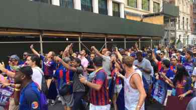Fans walk with soccer legend Thierry Henry after forming the world's largest FC Barcelona Jersey on July 22, 2017 in New York City to celebrate the kick-off of the team's US Tour.