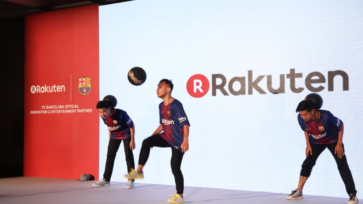 Performers showed off their lifting skills at the event to celebrate Rakuten's five years in Asia and its new partnership with FC Barcelona.