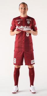Vissel Kobe's Andres Iniesta holding his new boot.