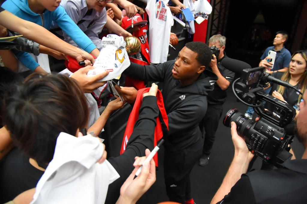 Fans reach for a lucky autograph from Raptors' four-time NBA All-Star Kyle Lowry.